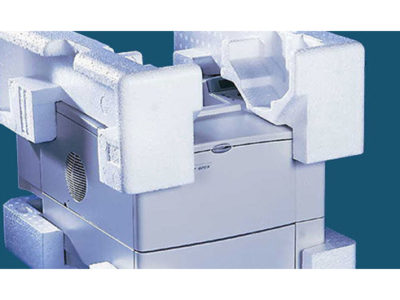 Photograph of a printer protected by foam packaging