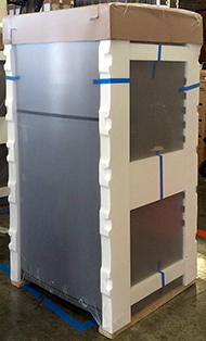 Photograph of fridge in protective packaging