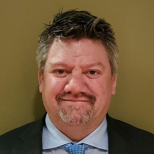 Photograph of Tom Barnes, CFO of Huntington Solutions